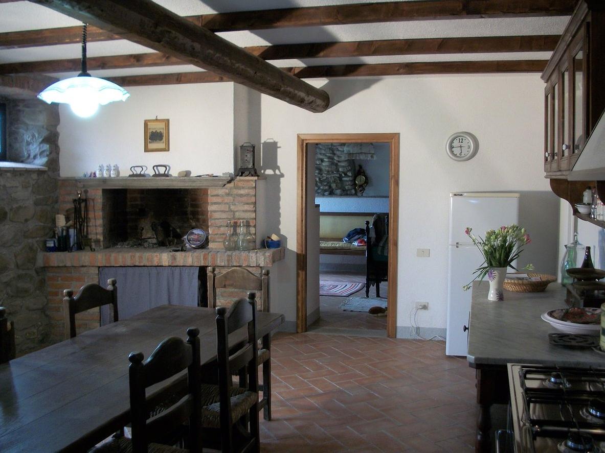Foto_soggiorno_con_camino_Coriana_Apartments_&_Villas