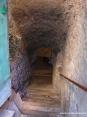 Caldana (GR) - Una delle caratteristiche del paese è quella delle numerose cantine sotterranee scavate nella roccia. In questa foto si vede la ripida scala di accesso ad una di tali cantine