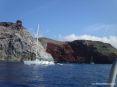 Isola di Capraia (LI) - Punta dello Zenobito si erge maestosa sul mare cristallino con la sua antica torre di fortificazione.