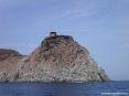 Isola di Capraia (LI) - Splendida vista della costa a picco sul mare. In alto si vede la sommità del paese con gli edifici dell