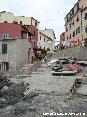 Marciana Marina (LI) - La zona del Cotone è davvero caratteristica. Le case color pastello si rispecchiano nel mare cristallino tra i gozzi, le tipiche barche di legno