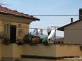 Monterchi (AR) - Oltre le case si scorge la campagna toscana con le sue verdi colline.