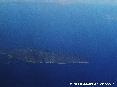 Isola del Giglio (Gr) - Foto aerea. Uno scatto da alta quota. La foto è stata scattatada una quota di circa 32000 piedi ovvero circa 10000 metri di altitudine dal livello del mare. (Luglio 2006)