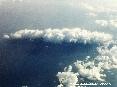 Isola del Giglio (GR) - Foto aerea. Uno scatto della splendida Isola del Giglio coperta da una fitta nuvola. La foto è scattata da circa 32000 piedi di altitudine ovvero da una quota di quasi 10000 metri dal livello del mare. (Ottobre 2006)