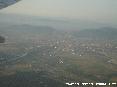 Pisa (Pi) - Foto aerea panoramica della città con lo sfondo dei Monti Pisani e di Lucca oltre il monte Serra.
