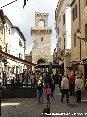 Piombino (LI) - Vista  di corso Vittorio Emanuale con lo sfondo del Torrione e del Rivellino